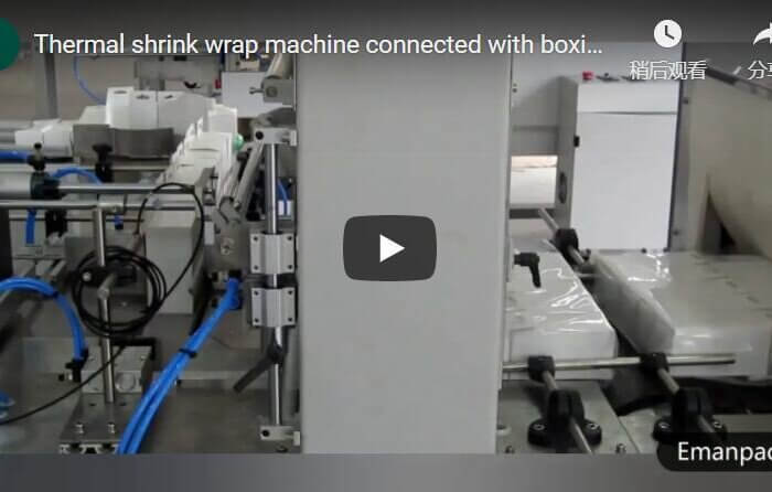 Sleeve sealing shrink wrapping machine for packing LED bulb boxes