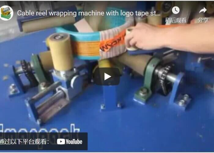 Cable reel wrapping machine with logo tape sticking mechanism