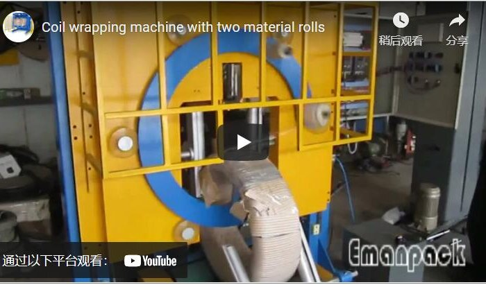 Coil wrapping machine with two material rolls