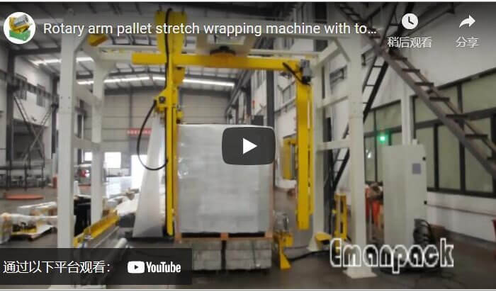 Rotary arm pallet stretch wrapping machine with top film dispenser